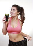 Woman with grenn juice. Brunette woman with green juice Royalty Free Stock Photo