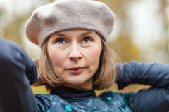 Woman in grey beret. Outdoor portrait of middle aged woman wearing grey beret Royalty Free Stock Image