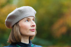 Woman in grey beret. Outdoor portrait of cheerful middle aged woman wearing grey beret Royalty Free Stock Photo