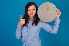 Woman with a grey clock Stock Photos