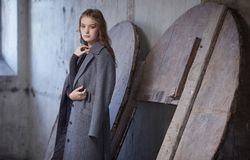 A woman in a grey coat. Stock Image
