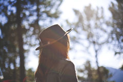 Woman in Grey Denim Jacket Wearing Hat Surrounded by Trees during Daytime Royalty Free Stock Photography