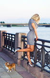 Woman in grey dress on a quay. Royalty Free Stock Photography