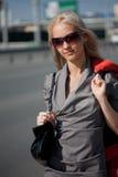 Woman in grey dress walking Stock Image