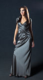 Woman in grey evening dress Stock Images