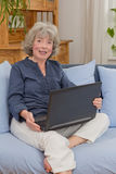 Woman with grey hair and laptop Royalty Free Stock Image