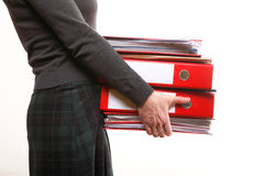 Female office worker carrying a stack of files Stock Images