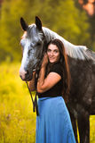 Woman and grey horse Royalty Free Stock Photos