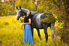 Woman and grey horse Stock Images