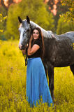 Woman and grey horse Stock Photo