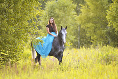 Woman and grey horse Royalty Free Stock Image