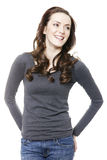 Woman in grey jumper. Attractive young woman in grey jumper smiling isolated on white background Royalty Free Stock Photos
