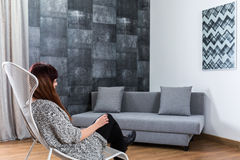 Woman in grey living room Stock Photos