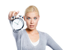 Woman showing the alarm clock Royalty Free Stock Photos