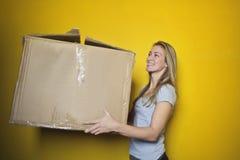 Woman In Grey Shirt Holding Brown Cardboard Box Royalty Free Stock Photos