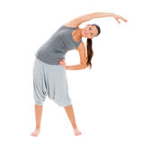 Woman in grey sportswear training Royalty Free Stock Photos