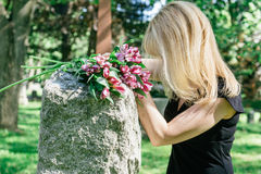 Woman Grieving at Grave Stock Photo