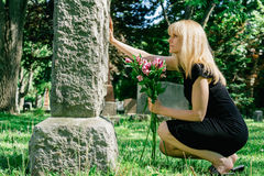 Woman Grieving at Grave Royalty Free Stock Photography