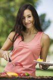 Woman Grilling Food at Park portrait. Stock Photography