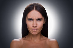 Woman grimacing. Royalty Free Stock Photography