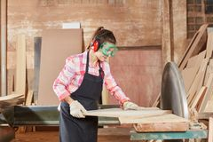 Woman with grinder machine. Woman woodworking with grinder machine Royalty Free Stock Image