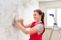 Woman grinding wall Royalty Free Stock Image