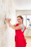 Woman grinding wall Stock Photo