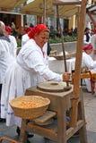 Woman grinds flour Royalty Free Stock Photos
