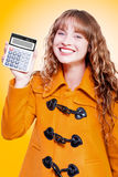 Woman grinning with glee holding calculator Stock Photos