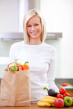 Woman with groceries Royalty Free Stock Images