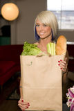 Blond Woman paper grocery bag fresh groceries Royalty Free Stock Images