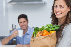 Woman with groceries bag Royalty Free Stock Photography