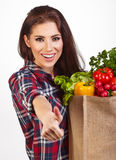 Woman with groceries shopping bag full of healthy vegetables smi Royalty Free Stock Photography
