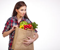 Woman with groceries shopping bag full of healthy vegetables smi Stock Photos