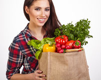 Woman with groceries shopping bag full of healthy vegetables smi Royalty Free Stock Image