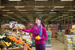 Woman At Groceries Store Stock Photos