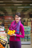 Woman At Groceries Store Royalty Free Stock Images