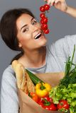 Woman with grocery bag Royalty Free Stock Photography