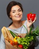 Woman with grocery bag Royalty Free Stock Images