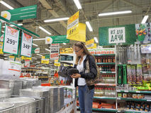 A woman of caucasian appearance makes purchases at the supermarket. Russia, summer 2017. Stock Photography