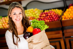 Woman grocery shopping Stock Photos