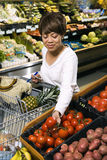 Woman grocery shopping. Royalty Free Stock Photography