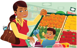 Woman grocery shopping with baby Stock Images