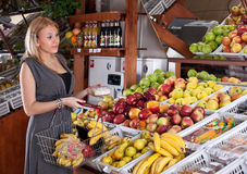 Woman grocery shopping in supermarket Stock Images