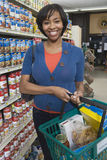 Woman With Grocery Shopping In Supermarket Stock Image