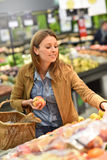 Woman at grocery store buying fruits Stock Photography