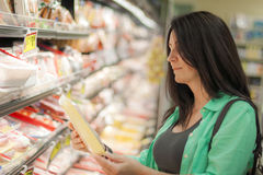 Woman in the grocery store Royalty Free Stock Photography