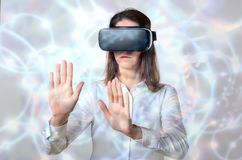 Woman groping objects in virtual reality stock image