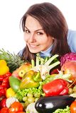 Woman with group of fruit and vegetables. Royalty Free Stock Images