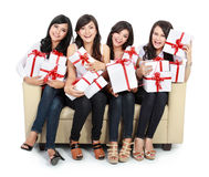 Woman group holding gift boxes Royalty Free Stock Photography